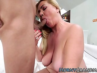 Busty granny rides cock