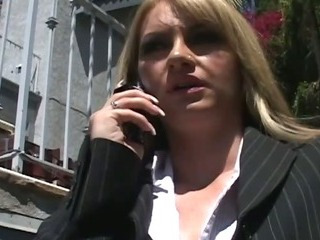 Hot businesswoman on a black..